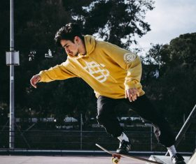 Stock Photo Young people skateboarding on the street