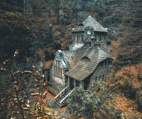Stone house in the woods in the mountains Stock Photo