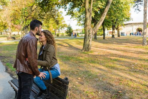 Sweet couple on park bench Stock Photo