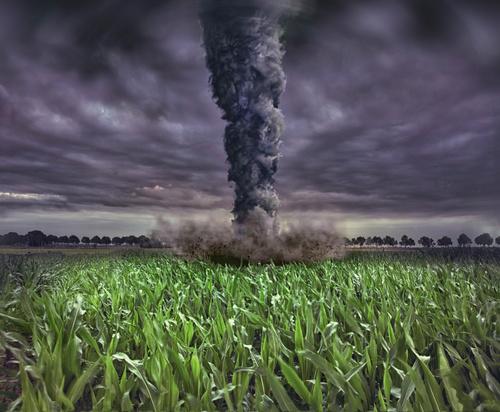 Tornado attacking farmland Stock Photo