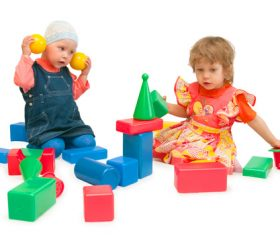 Two children playing with blocks Stock Photo