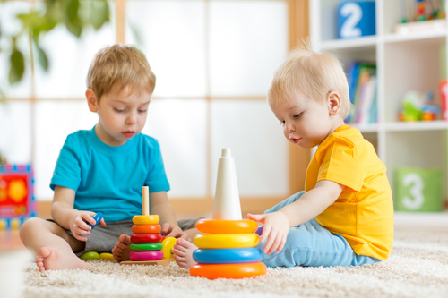 Two children playing with toys Stock Photo free download