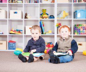Two children reading comic books Stock Photo