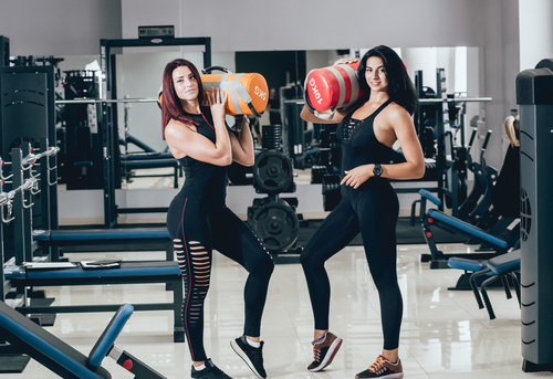 Two sporty women in the gym Stock Photo