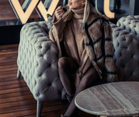 VIP interior wearing fur coat fashion woman Stock Photo