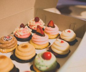 Various cupcakes in the box Stock Photo