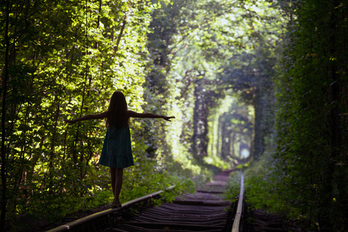Walking on the rails girl Stretch hands Stock Photo