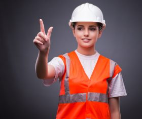 Wearing hard hat wearing overalls woman gesturing Stock Photo 01
