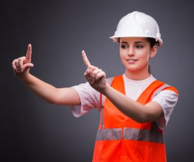 Wearing hard hat wearing overalls woman gesturing Stock Photo 03