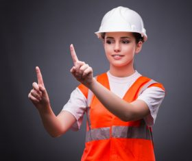 Wearing hard hat wearing overalls woman gesturing Stock Photo 04