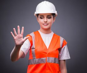 Wearing hard hat wearing overalls woman gesturing Stock Photo 05