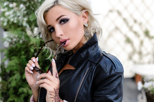 Wearing leather jackets makeup woman Stock Photo