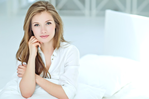 Wearing white shirt and blue eyed woman with long hair Stock Photo