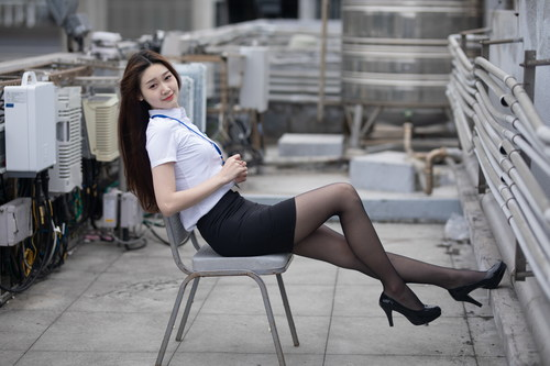 White collar woman in uniform stockings Stock Photo