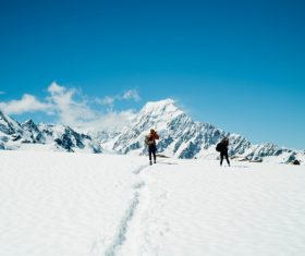 Winter mountaineering couple Stock Photo