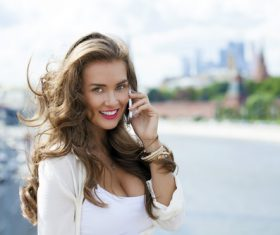 Woman answering the phone on the street Stock Photo 02