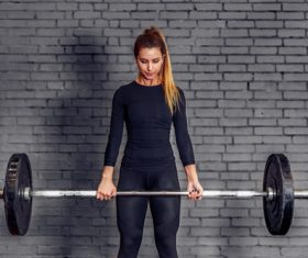 Woman doing barbell exercise Stock Photo