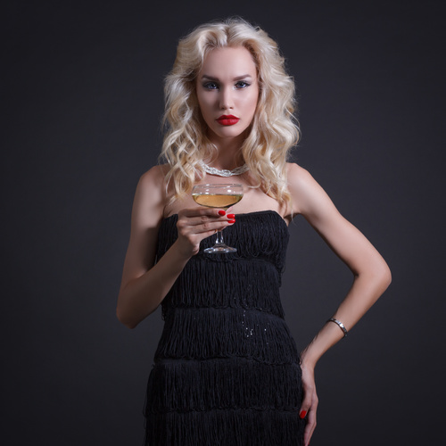 Woman holding a glass of champagne Stock Photo 01