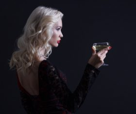 Woman holding a glass of champagne Stock Photo 02