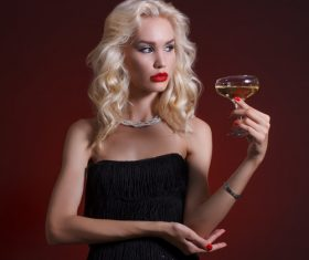 Woman holding a glass of champagne Stock Photo 03