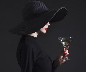 Woman holding a glass of champagne Stock Photo 04