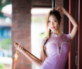 Woman in pink dress holding flute Stock Photo