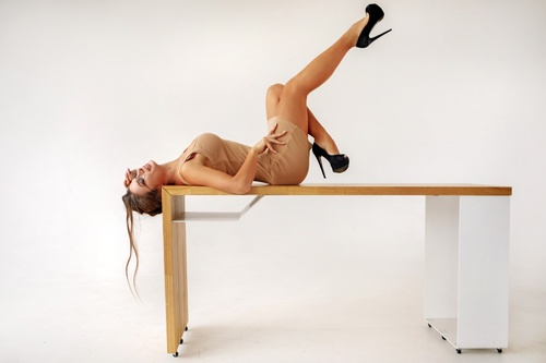 Woman lying on the table posing Stock Photo