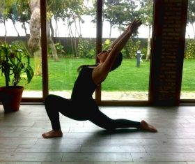 Woman practicing yoga indoors Stock Photo 01