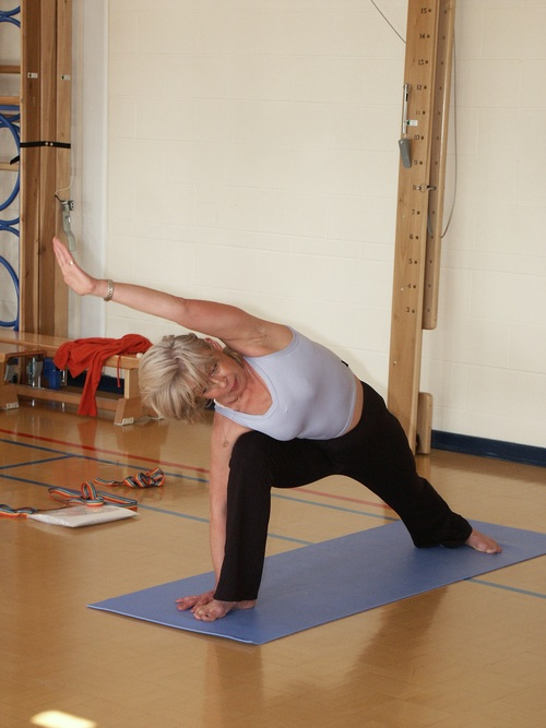 Woman practicing yoga indoors Stock Photo 02