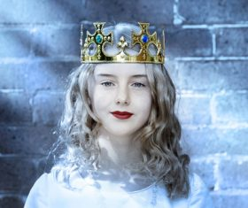 Woman wearing crown Stock Photo