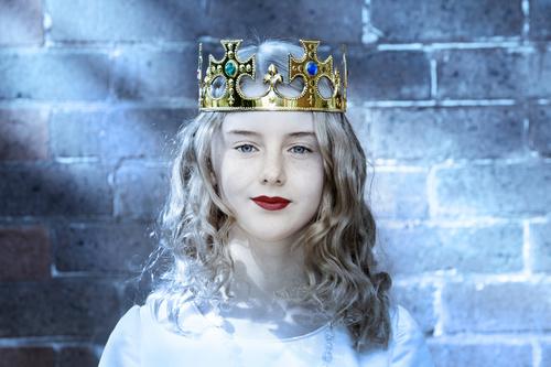 Woman wearing crown Stock Photo