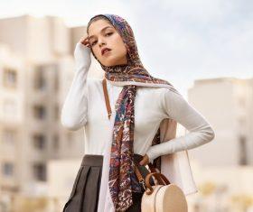 Woman wearing flower headscarf posing Stock Photo
