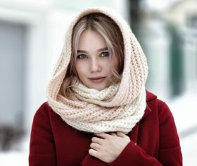 Woman wearing knit scarf outdoor in winter Stock Photo