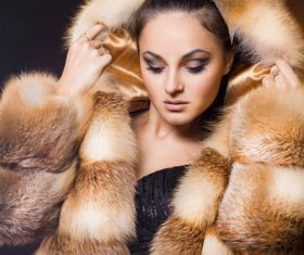 Woman wearing warm mink coat Stock Photo 01