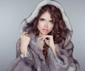 Woman wearing warm mink coat Stock Photo 03
