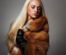 Woman wearing warm mink coat Stock Photo 04