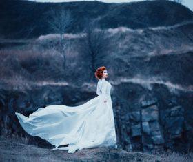 Woman wearing white long dress outdoors Stock Photo