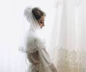 Woman wearing white traditional wedding dress Stock Photo