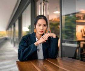 Women model asian sitting at the wooden table Stock Photo