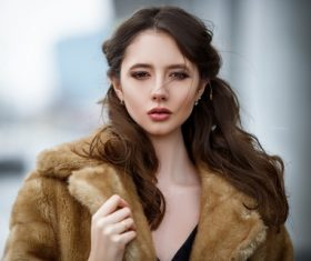 Young beautiful woman wearing mink coat Stock Photo