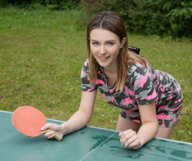 Young girl playing table tennis Stock Photo