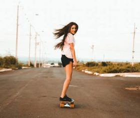 girl riding skateboard at the road Stock Photo