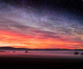 sunset starry night mist Stock Photo