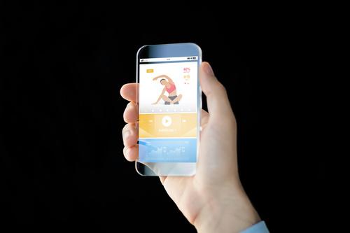 Сlose up of sport app on smartphone Stock Photo 01