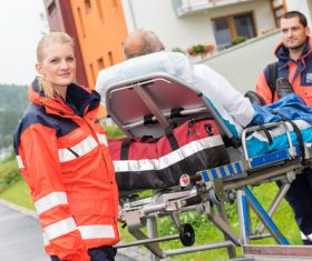 Ambulance personnel transfer patients Stock Photo