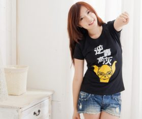 Asian woman wearing black T-shirt short jeans Stock Photo