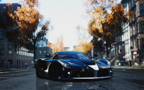 Black Ferrari LaFerrari race cars parked in the middle of the road Stock Photo