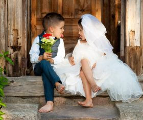 Children dressed as grooms and brides Stock Photo 01