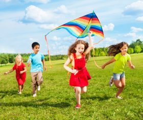 Children flying kites Stock Photo