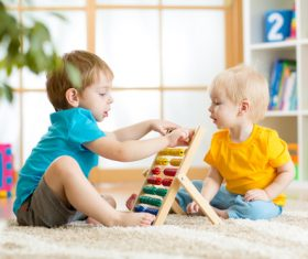 Children playing abacus Stock Photo